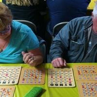 man and woman playing bingo