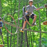 two boys on high wire adventure course