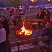 people at a bonfire at campground