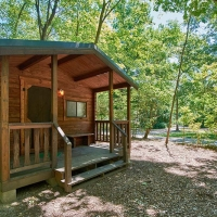 outside of small cabin at campground