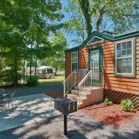 Outside of small cabin with patio