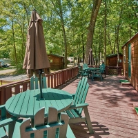 deck on cabin with tables and chairs