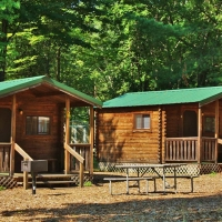 exterior of two cabins with picnic table