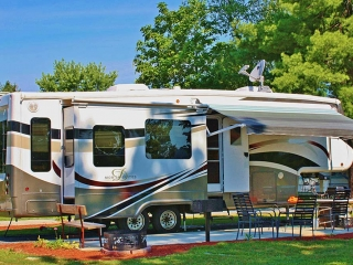 White and brown camper with awning