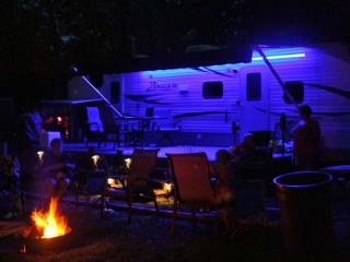 camper at night with a bonfire