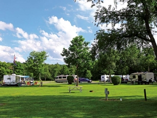 camping resort with campers and picnic table