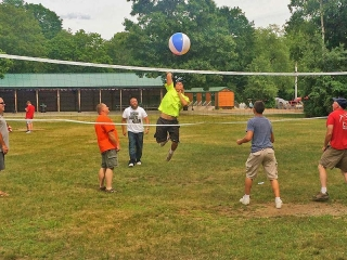 boys playing volleyball with a beach ball
