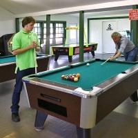two men playing billiards