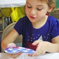girl making a craft