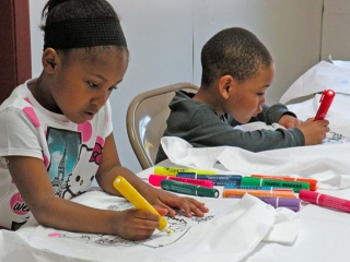 kids coloring with markers