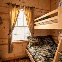 Bunkbeds with stairway and window