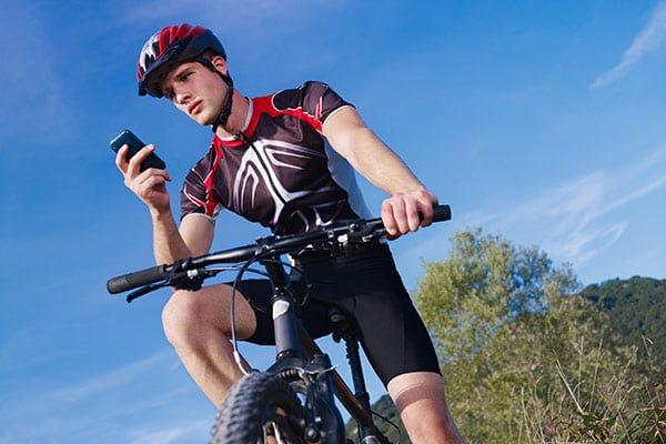 man on bike looking at phone